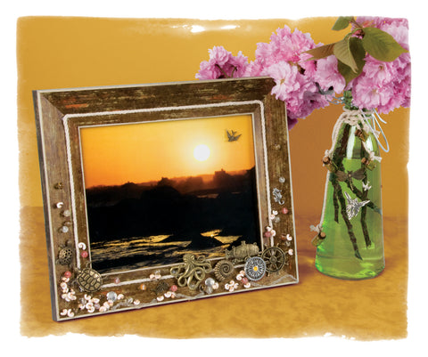 Picture frame with steampunk charms and vase with steampunk decorations