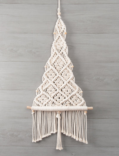 Solid Oak brand macrame kit - Chrismtas tree shown on grey wood wall.