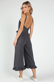 STRIPED WRAP JUMPSUIT WITH RUFFLE DETAIL