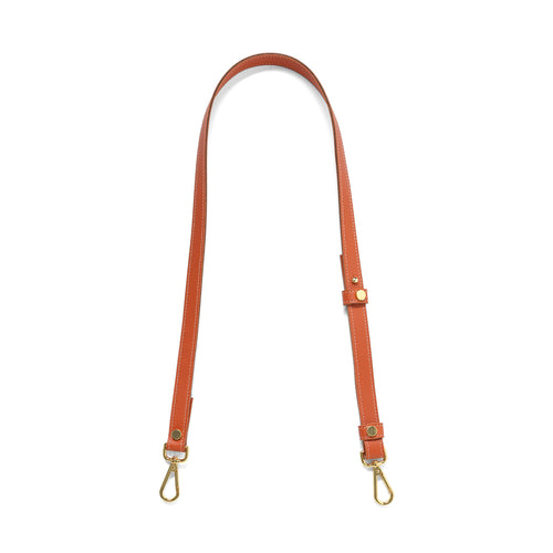 Pumpkin leather cross body strap with gold tone clasps