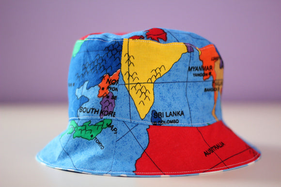 34e53dce806 Reversible Sun Hat - World Map 6-12mths