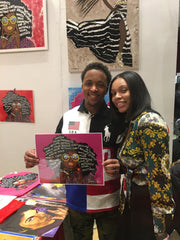 african american females holding their purchased art prints at the harlem fine arts show