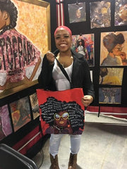 african american female showing off her watch your thoughts tote bag created by artist Diedria Pigues at the Black christmas expo in Memphis TN