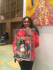 Young black female purchasing an art print created by artist Diedria Pigues at the Harlem Fine Art Show