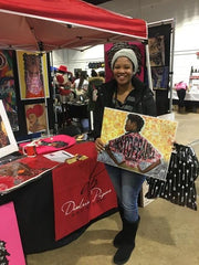 african american female holding her unstoppable queen art print during the Soulful Food Truck Festival in Memphis TN