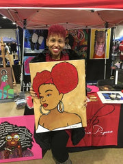 african american female holding her purchase original art by artist Diedria Pigues at the soulful food truck festival in Memphis tn