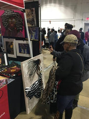 visitors loving the artwork of artist Diedria Pigues during the Soulful Food Truck Festival in Memphis TN