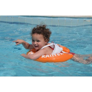 A boy toddler having fun swimming using the Swim Trainer, Swim Accessories advice, for disabled children.