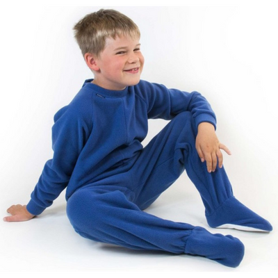 Boy sitting in blue fleece All-In-One Pyjamas, Protective clothing, for disabled children.