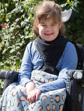 Load image into Gallery viewer, Girl in wheelchair wearing black Cotton Towelling Kerchief, Protective bib, for disabled children.