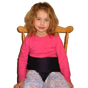 Older child sitting in Dining Chair Harness, Care & safety, for disabled children.