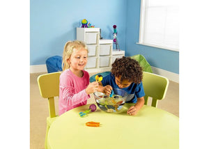 Boy and girl playing with Fine Motor Toolkit, motor and cognitive skills, for children with disabilities.