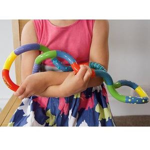 Large Tangled Texture, Bright colours of blue, green, red and yellow with some spot and stripe textures, a squiggly loopy toy, sensory product, for children with disabilities.