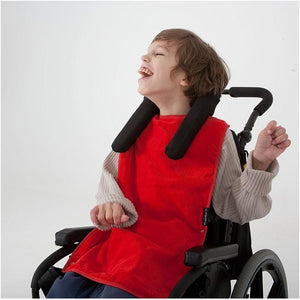 Boy wearing Red Mum 2 Mum PLUS Clothing Protector Supersized, Protective Bib, for disabled Children