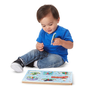 Boys playing with Nursery Rhymes Sound Puzzles, motor and cognitive skills, for disabled children.
