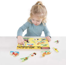 Load image into Gallery viewer, Girl playing with Pet Sound Puzzles, motor and cognitive skills, for disabled children.