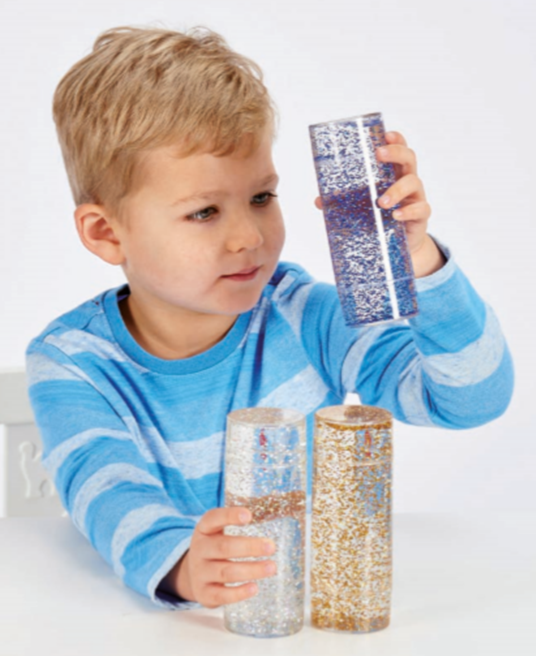 Boy playing with Sensory Glitter Storm Cylinder Toy, Learning resources, for disabled children.