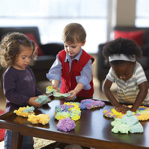 Children playing with Rainbow Blocks Playfoam, motor and cognitive skills, for children with disabilities.