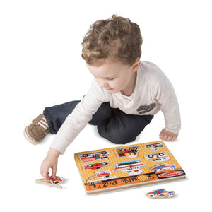 Boy playing with Vehicles Sound Puzzle. Sensory integration, for children with disabilities.