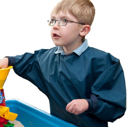 Boy wearing waterproof PVC overall, Protective Bib, for disabled children.