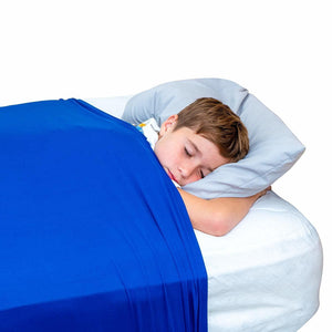 Boy sleeping with the  sensory compression body sock blue, Sensory Bedding for disabled children.