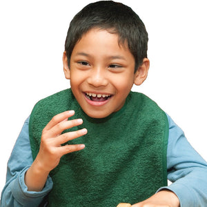 Boy in wheelchair wearing green Feeding Apron, Protective bib, for disabled children.
