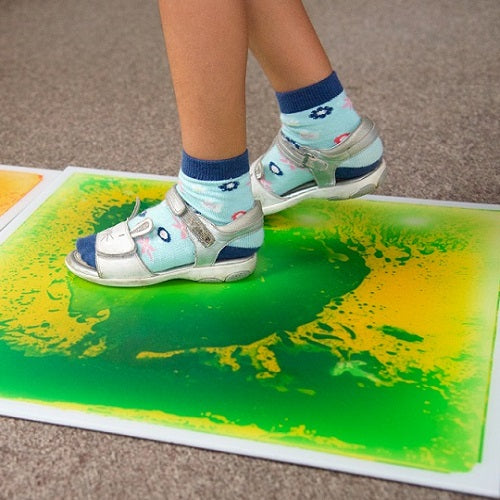 Feet on green Liquid Floor Tile - Large, sensory integration, for children with disabilities.