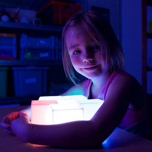 Girl playing with Colour Changing Mood Block, sensory integration, for children with disabilities.