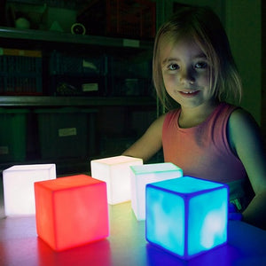 Girl playing with Colour Changing Mood Blocks, sensory integration, for children with disabilities.