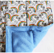 Unicorn and rainbow patterned weighted blanket with a sky blue fleece underlayer, sensory integration, for disabled children.