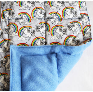unicorn and rainbow patterned weighted blanket with a sky blue fleece underlayer, sensory integration, for children with disabilities