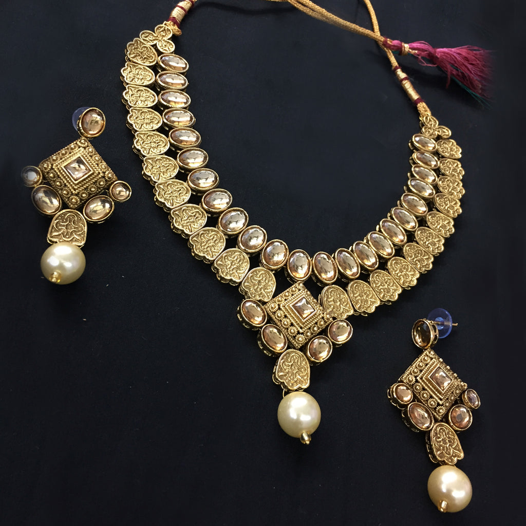 Exclusive Kundan Gold Jewelry Set - HVIJS0062