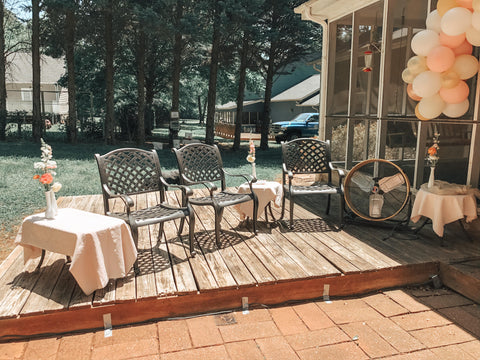 Chairs spaced 6 feet apart at an outdoor baby shower during the Covid-19 pandemic