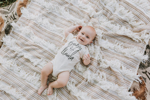 Baby Boy on Blanket Wearing Baby Llama Cream Organic Cotton Onesie
