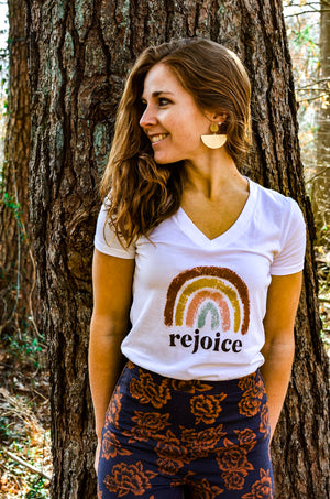 Woman Against Tree Wearing Rainbow Rejoice Hemp V-Neck White Women's T-Shirt