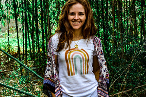 woman wearing rainbow women's white sustainable t shirt