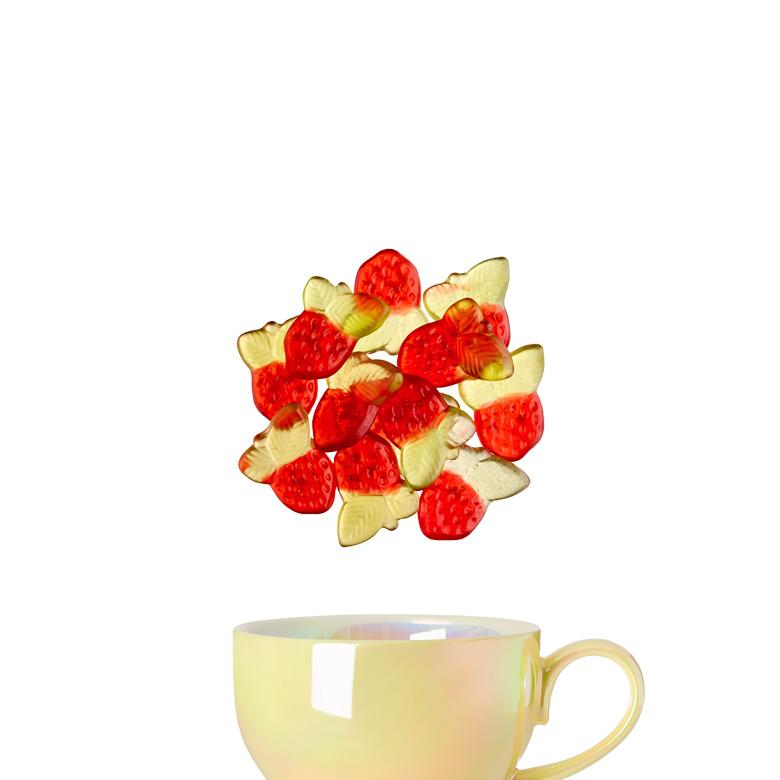 Yellow opalescent bloom tea cup with Strawberry Rhubarb