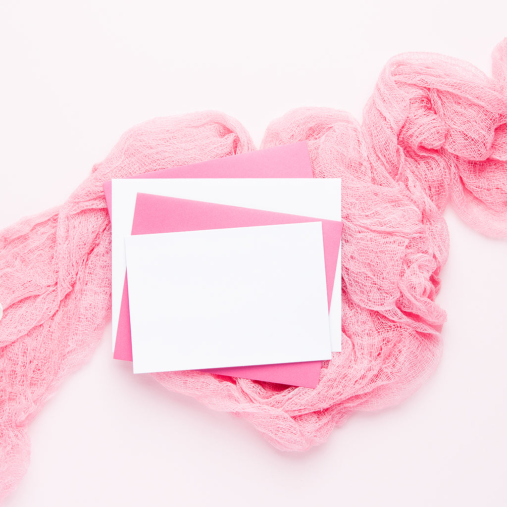 styled stationary stock photo flat lay with a card mock up and pink envelopes
