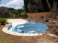 Hydroseal beach entry swimming pool with blue