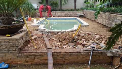 Paving removed around old swimming pool