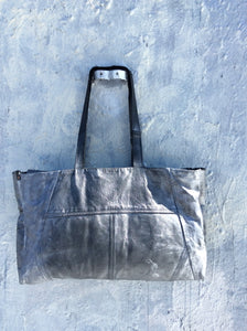 Silver Travel leather statement Duffle bag.