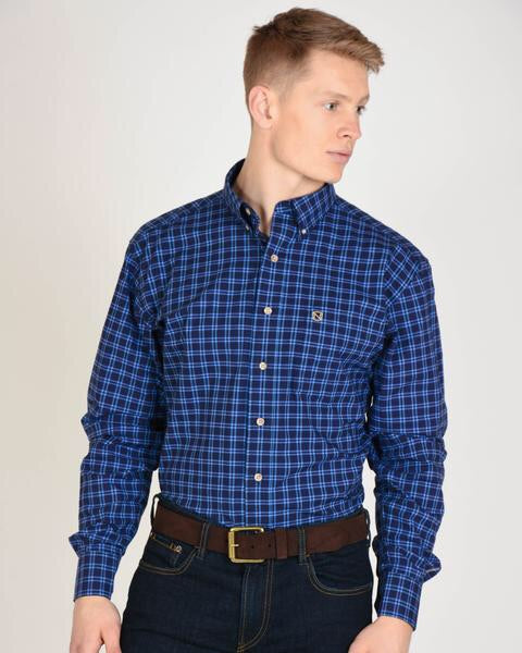 Model Wearing Generations Long Sleeved Plaid Shirt in Navy with Noble Outfitters Logo on Pocket