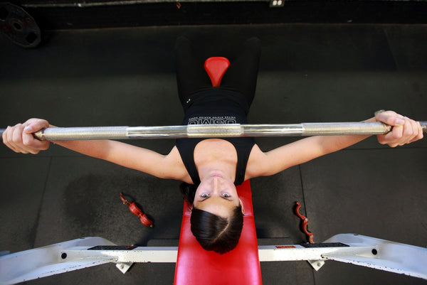 Girl in press doing lifting