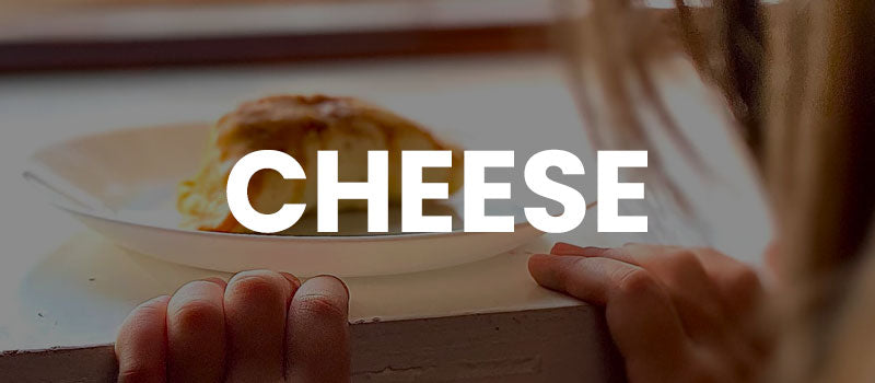 """Image of empanadas overlaid with the word """"Cheese"""""""