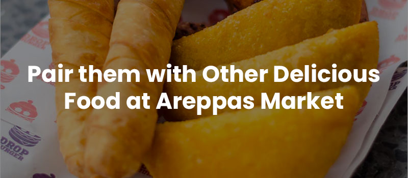 """An image of tequenos with the text overlay """"Pair them with Other Delicious Food at Areppas Market"""""""