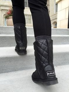 SoHo Black Nappa cross stitched black leather mid-size sheepskin ugg boots, featuring water resistant cross-stitch outer finish with Swarovski crystal logo