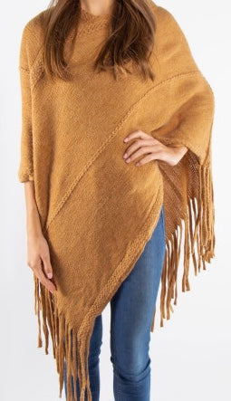 Knit-poncho-with-tassles