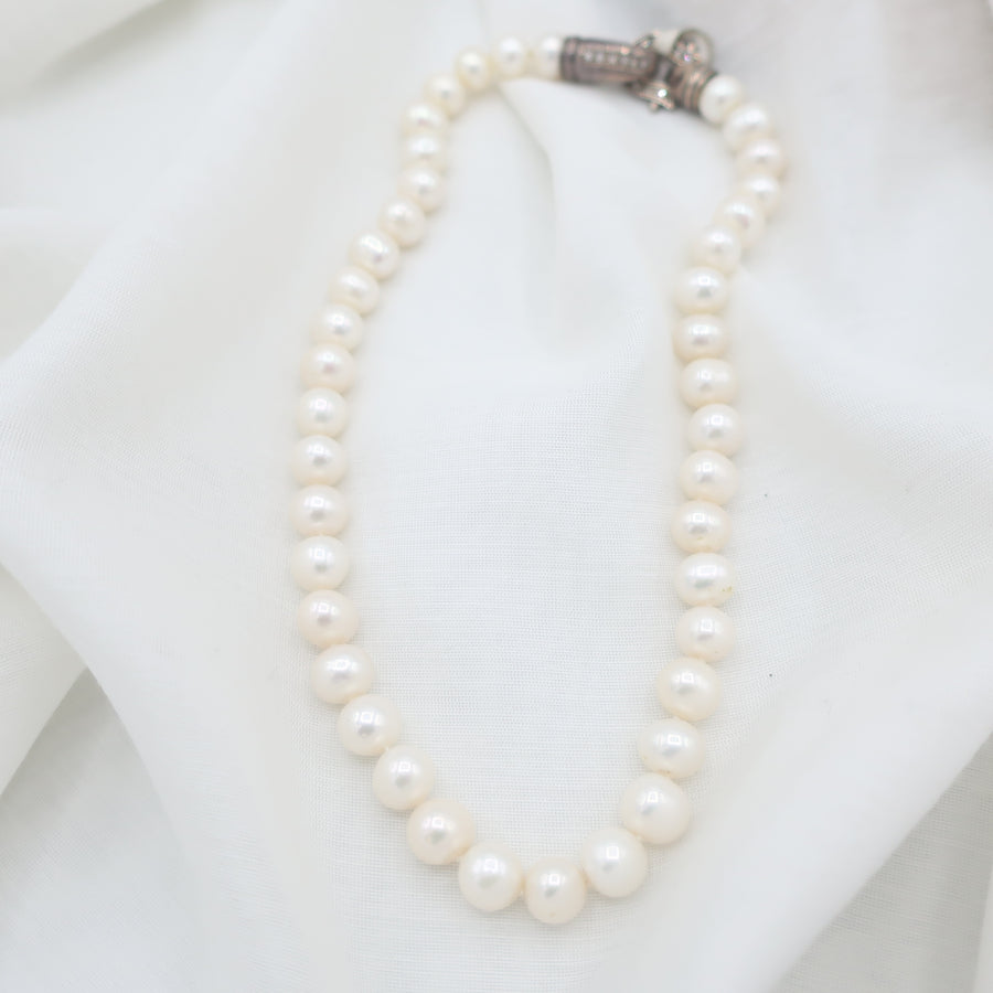 Hand- Knotted Pearl Necklace