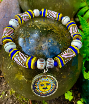Silver Sun God Charm and African Bead Bracelet