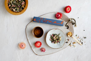 Shanghai tea blend by The Tea Nomad- a floral, white tea featuring chrysanthemum and osmanthus flowers, pink rose petals and a touch of lychee.